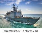 Grey modern warship sailing in the sea