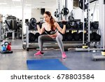 fitness girl making squat with... | Shutterstock . vector #678803584