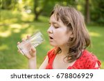 young woman is drinking water... | Shutterstock . vector #678806929
