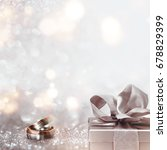 wedding rings with a present on ... | Shutterstock . vector #678829399