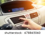 driver hand tuning air... | Shutterstock . vector #678865060