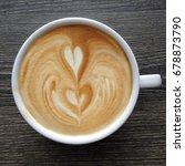 top view of a mug of latte art...   Shutterstock . vector #678873790