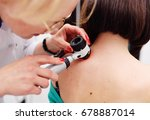 the dermatologist examines the... | Shutterstock . vector #678887014