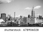 Small photo of The Empire State Building in the Skyline of Manhattan Midtown - MANHATTAN / NEW YORK - APRIL 2, 2017