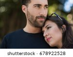 young pensive couple cuddling... | Shutterstock . vector #678922528