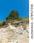 tree grows on top of sandstone  ...   Shutterstock . vector #678927358