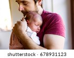 young father at home holding... | Shutterstock . vector #678931123