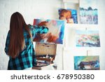 young artist girl at work in... | Shutterstock . vector #678950380