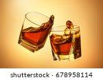 two whiskey glasses clinking... | Shutterstock . vector #678958114