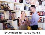 happy young couple choosing... | Shutterstock . vector #678970756
