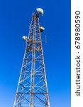 Small photo of Radio TV Mobile Communications Tower Steel tower for radio tv mobiles signal communication airwaves with blue sky background