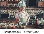 cute little girl in chef's hat... | Shutterstock . vector #679040854