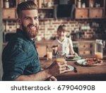 handsome bearded man is holding ... | Shutterstock . vector #679040908