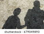 shade and shadow of mother and... | Shutterstock . vector #679049893