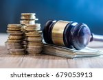 Gavel With Euro Banknotes And...