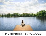 nature getaway.  woman sitting... | Shutterstock . vector #679067020