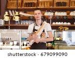 handsome male baker in black... | Shutterstock . vector #679099090