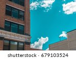 big city building on a cloudy... | Shutterstock . vector #679103524