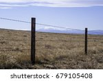 barbed wire fence to contain... | Shutterstock . vector #679105408