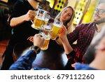 friends clink glasses of beer... | Shutterstock . vector #679112260