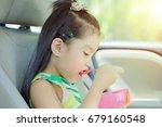 a young girl eating breakfast... | Shutterstock . vector #679160548