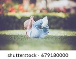 baby boy falling on the grass | Shutterstock . vector #679180000