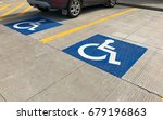 handicapped parking sign on a... | Shutterstock . vector #679196863
