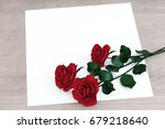 red roses with paper on the... | Shutterstock . vector #679218640