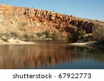 mirror lake and sandstone cliffs