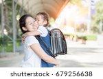 mother hug and kiss cute girl... | Shutterstock . vector #679256638