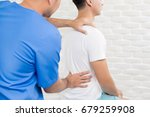 male doctor therapist treating... | Shutterstock . vector #679259908