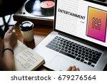 hands working on laptop network ... | Shutterstock . vector #679276564