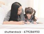 happy family in the bedroom... | Shutterstock . vector #679286950