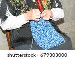 woman realizes a wool sweater... | Shutterstock . vector #679303000