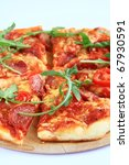 Pizza with tomatoes and herbs - stock photo