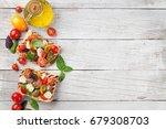 bruschetta with cherry tomatoes ... | Shutterstock . vector #679308703
