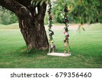 beautiful wooden wedding swing... | Shutterstock . vector #679356460