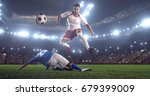 football players tackling for... | Shutterstock . vector #679399009
