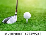 golf club and ball on green... | Shutterstock . vector #679399264