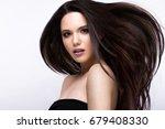 beautiful brunette girl in move ... | Shutterstock . vector #679408330