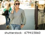 woman using phone | Shutterstock . vector #679415860