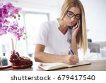 young woman working at the... | Shutterstock . vector #679417540