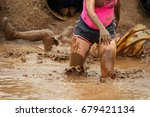 mud race runners in the... | Shutterstock . vector #679421134