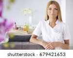 smiling woman waiting for... | Shutterstock . vector #679421653