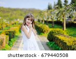 portrait of happy little girl... | Shutterstock . vector #679440508