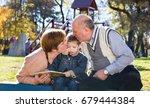 grandparents with grandson...   Shutterstock . vector #679444384