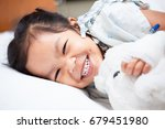sick asian child girl is lay... | Shutterstock . vector #679451980