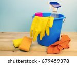a cleaning bucket with sponges... | Shutterstock . vector #679459378