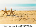 two starfish with ocean. on... | Shutterstock . vector #679470094