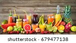 various freshly squeezed fruits ... | Shutterstock . vector #679477138